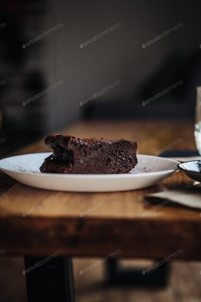 Slice of vegan chocolate brownie cake
