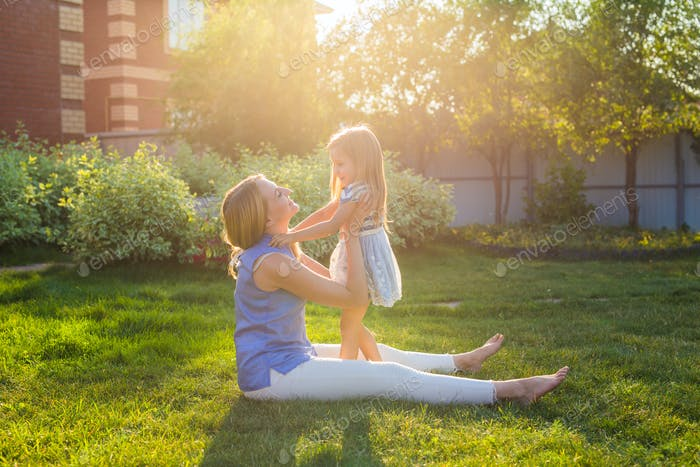 Portrait of happy loving mother and her baby outdoors.