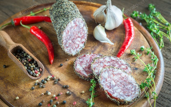 Slices of saucisson on the wooden board