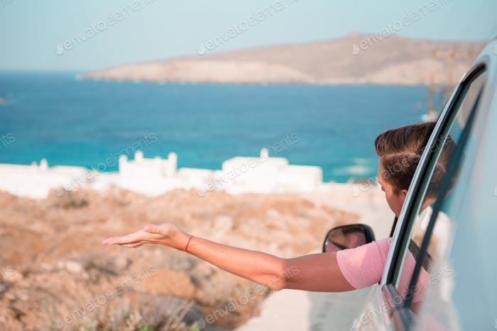 Tourist man on vacation travel by car. Summer holiday and car travel concept