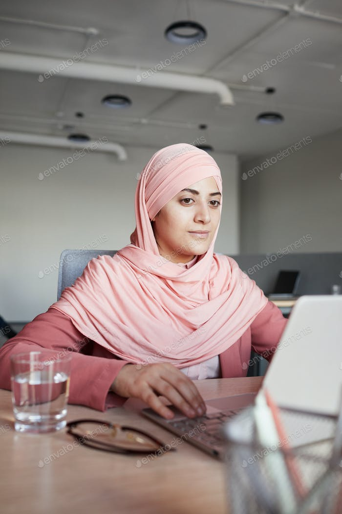 Young Muslim Businesswoman at Workplace