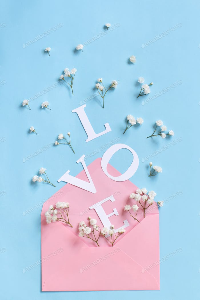 Flowers, envelope and word LOVE on a light blue background