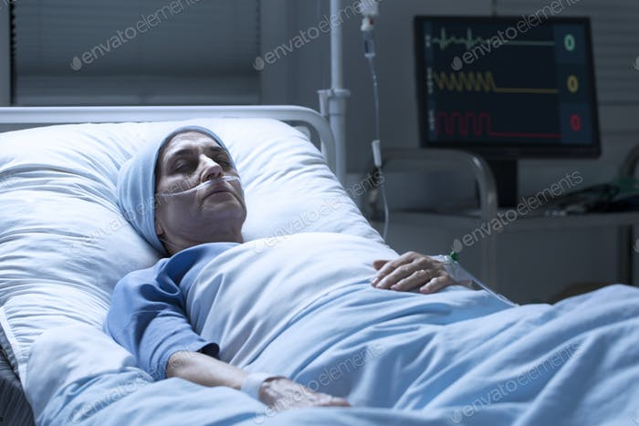 Middle-aged woman with cancer dying