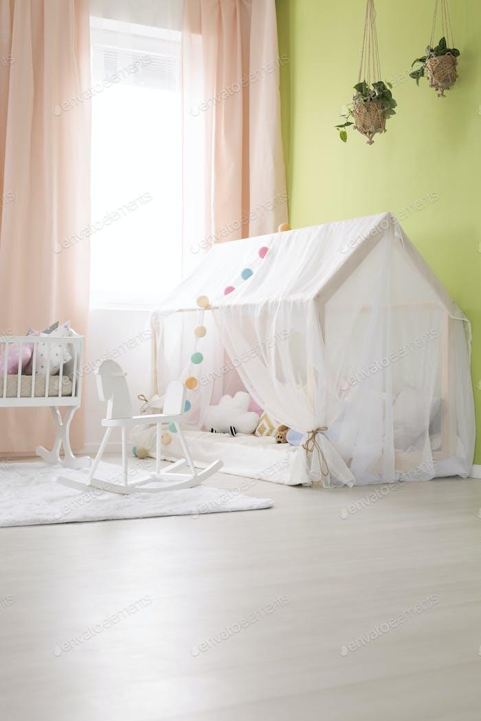 Nursery with green wall