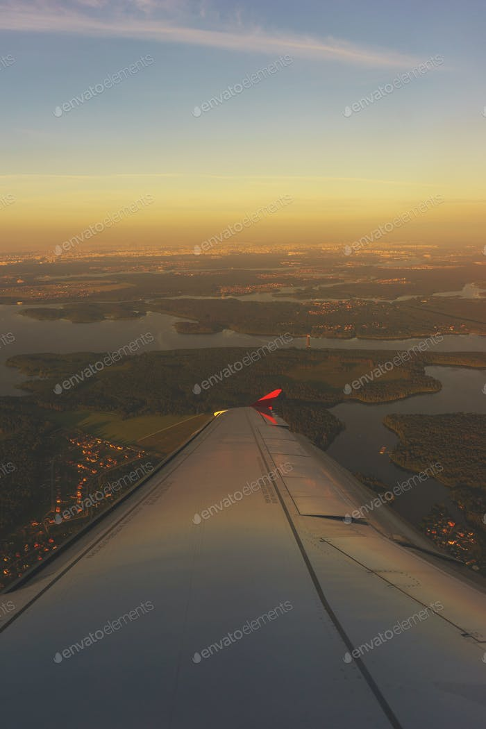 aerial view from the window of a passenger airliner in flight