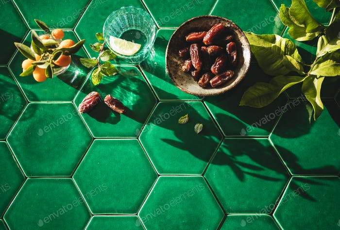 Flat-lay of dates and fresh drinking water for Ramadan month