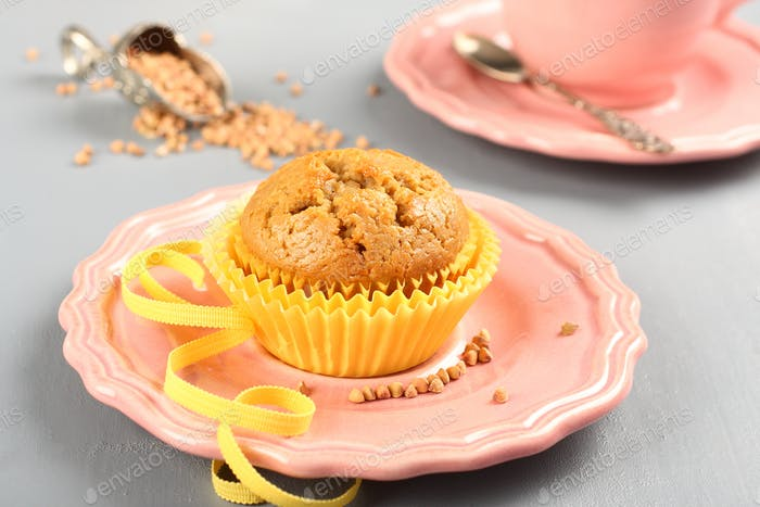 Freshly baked buckwheat muffins on the rose plate