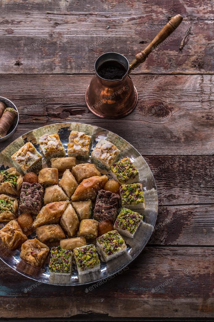 Arabian sweets and delights with coffee on rustic table