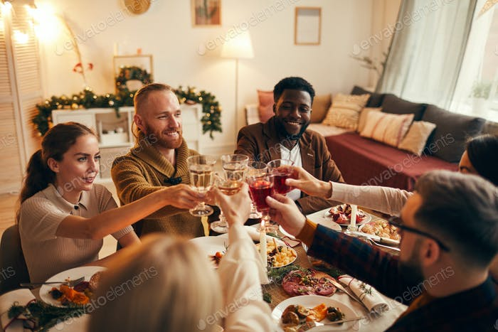 Group of Friends Raising Glasses at Dinner Party