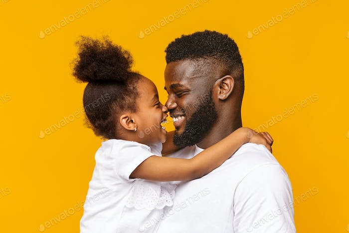 African daddy and his little daughter touching noses