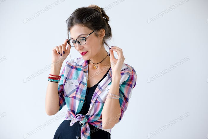 Attractive positive young woman in glasses