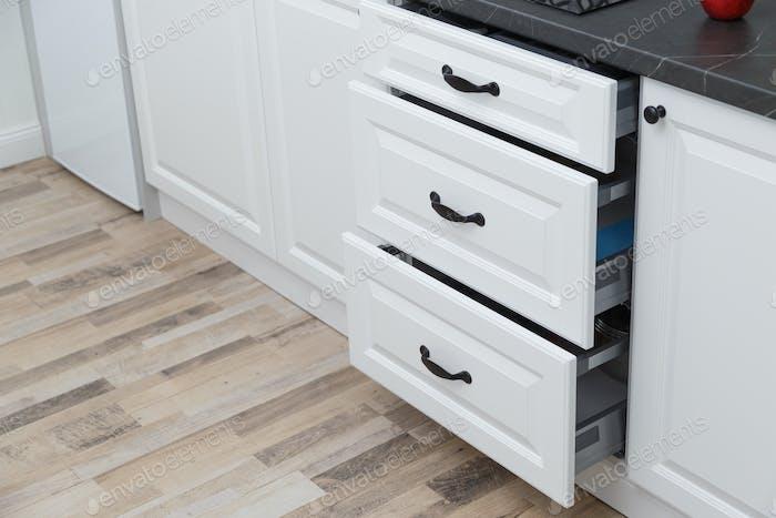 Kitchen furniture. White kitchen drawers