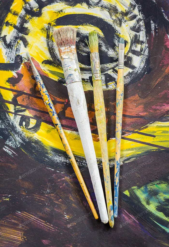 Set of paint brushes on oil painting