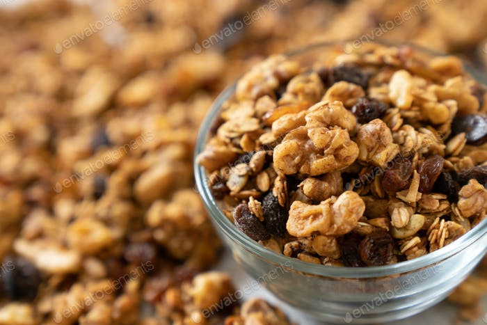 Granola cereal with oats, pumpkin seeds, walnuts, and raisins
