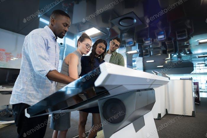 Business executives touching digital screen