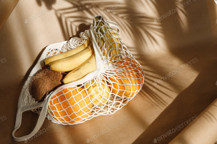 Creative summer food still life with bananas, coconut, oranges and lemons.