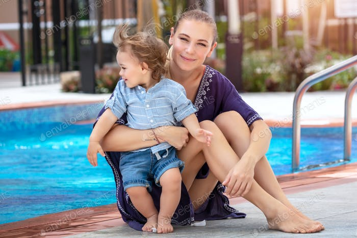 Mother with baby near the pool