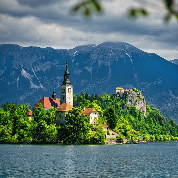 Bled Lake with church and mountains in background