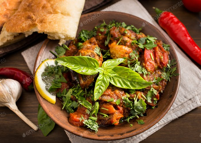 Chicken stewed with tomatoes and herbs