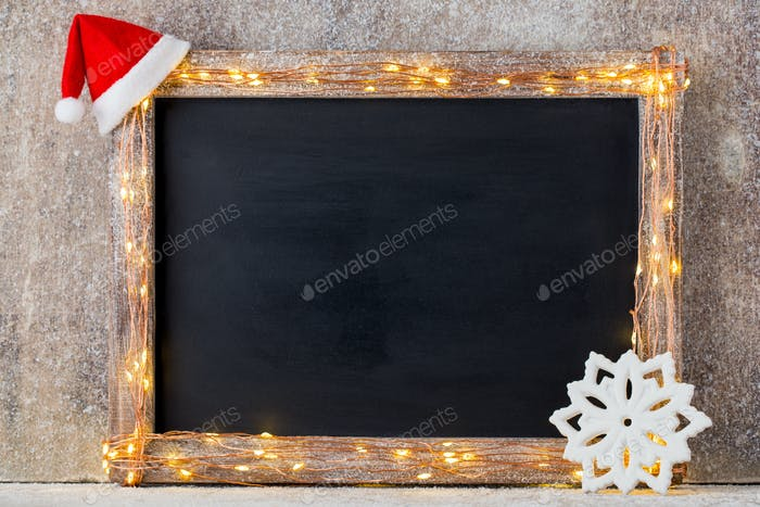 Christmas rustic background - vintage planked wood with lights and christmas decoration.