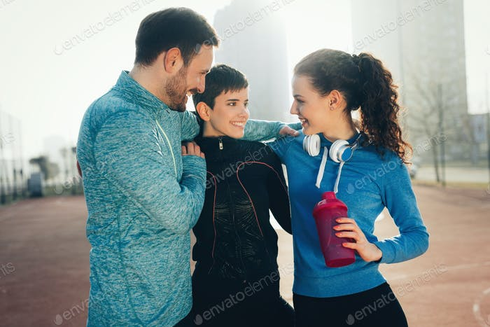 Friends fitness training together outdoors living active healthy