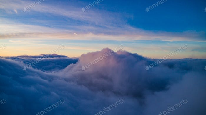 Magical view of cumulus clouds in winter at sunset