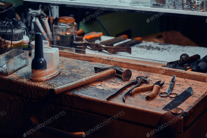 Workplace of cobbler with necessary tools on it