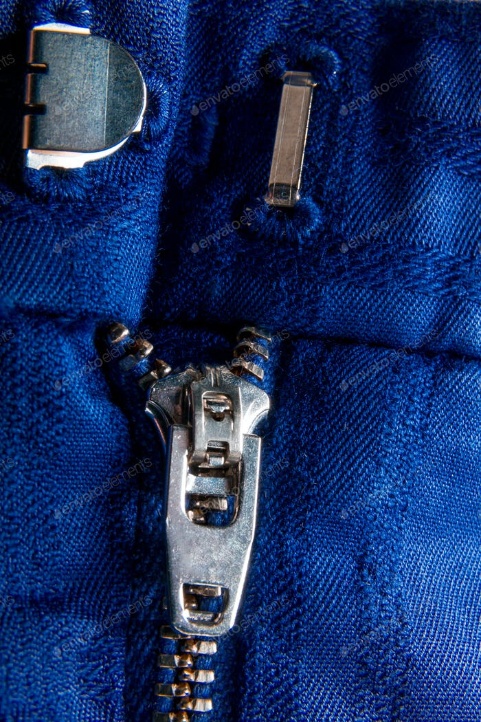 Fragment of blue jacket with metal zipper. ziplock background. Close up.