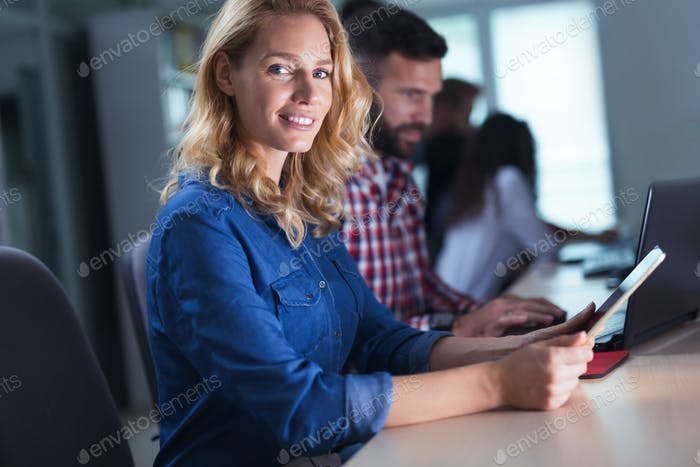 Blonde woman working at information technology company