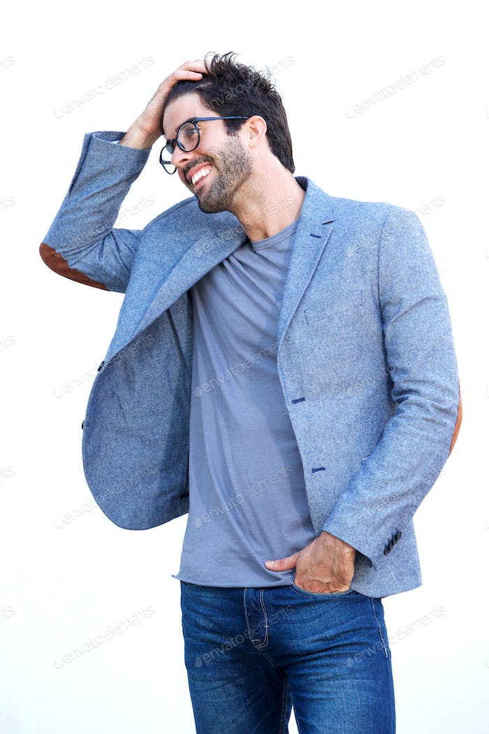 Handsome man in blue blazer standing with hand in hair