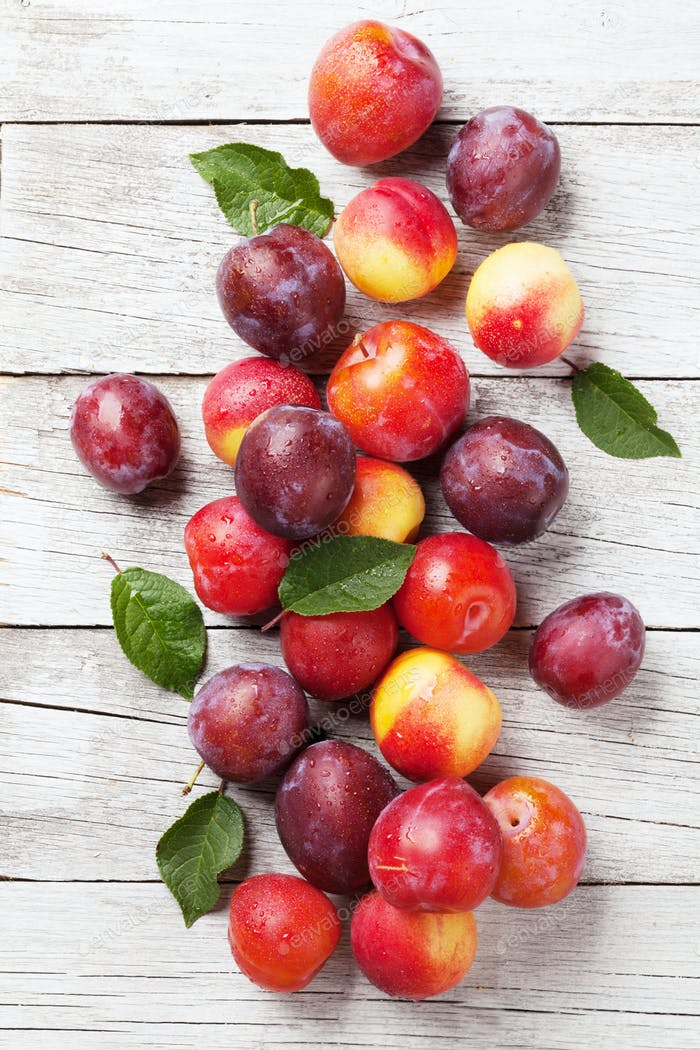 Fresh ripe peaches and plums