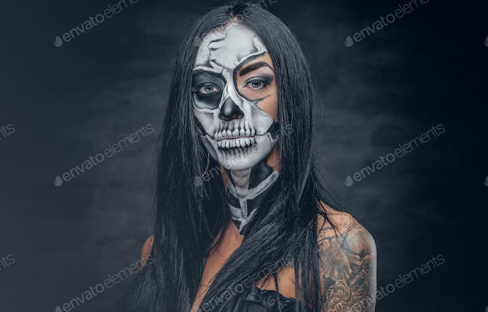 A woman with painted skull face.