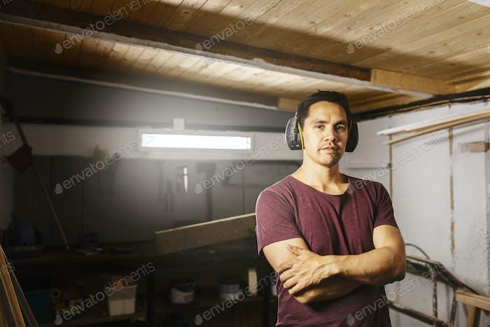 Portrait of man wearing ear muffs