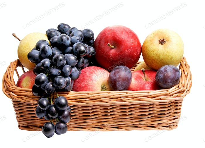 Ripe autumn fruits at the wooden basket.