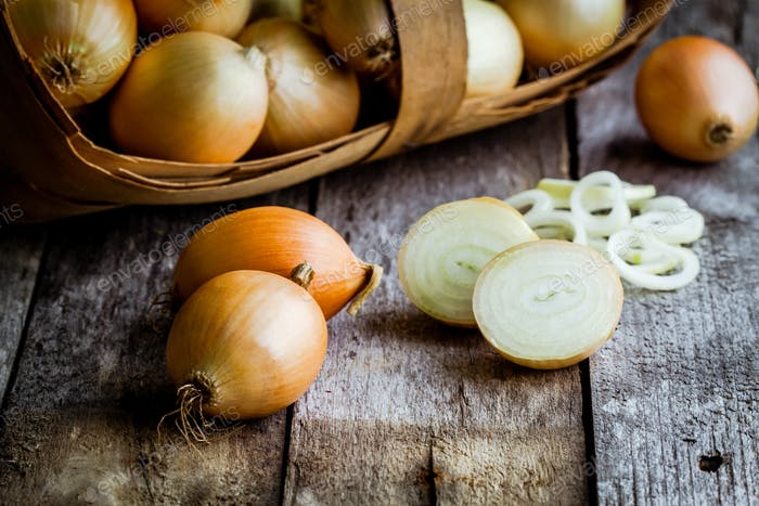 Fresh organic onions in a basket