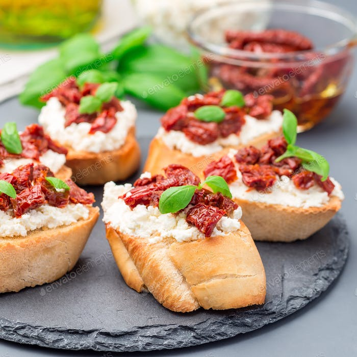 Bruschetta with sun dried tomato, feta and philadelphia cheese a