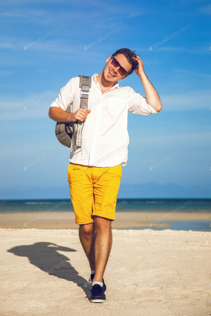 Young handsome hipster man relaxed at sunny day