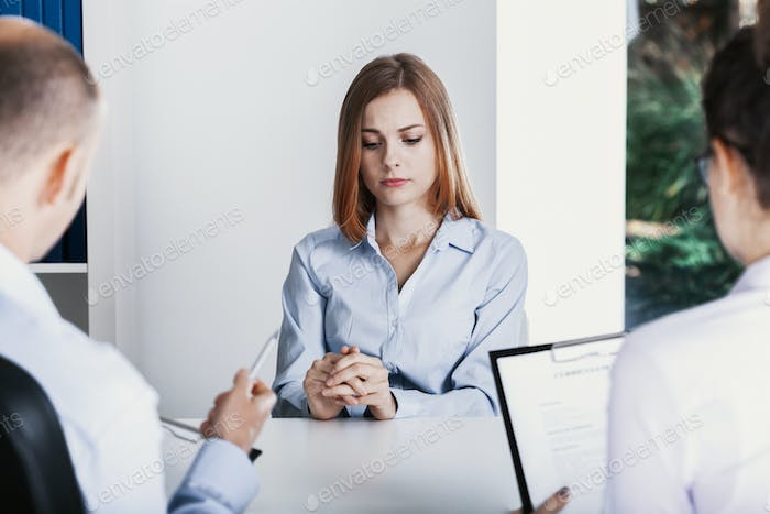 Nervous young apprentice during a job interview in a corporation