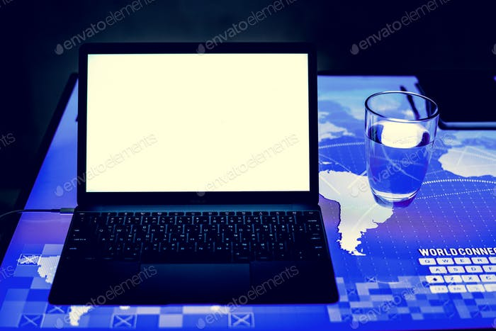 Laptop on a digital desk cyber space