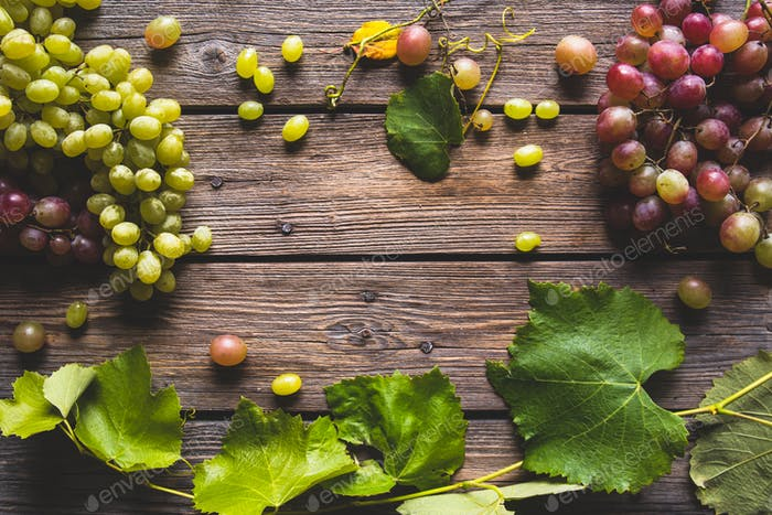 green and red grapes on a wooden background. healthy food