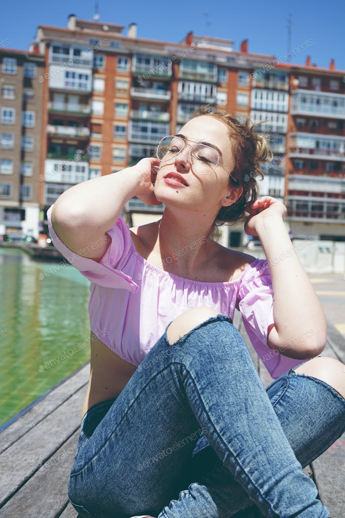 Beautiful woman enjoying the day in the city