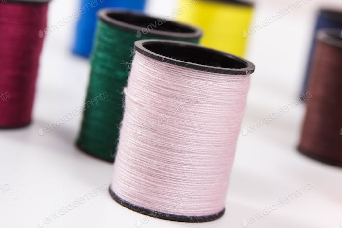 Colorful spools of thread. Accessories for needlework