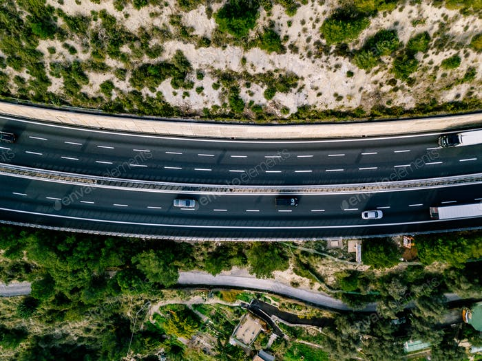 Aerial view of summer landscape with road. Highway with cars in rural Italy.