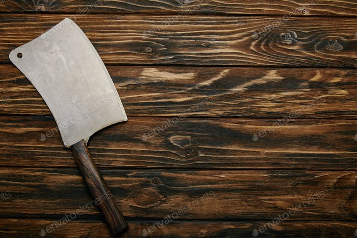 top view of butcher knife on wooden background