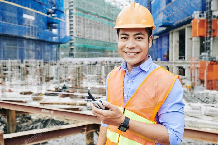 Happy engineer at construction site