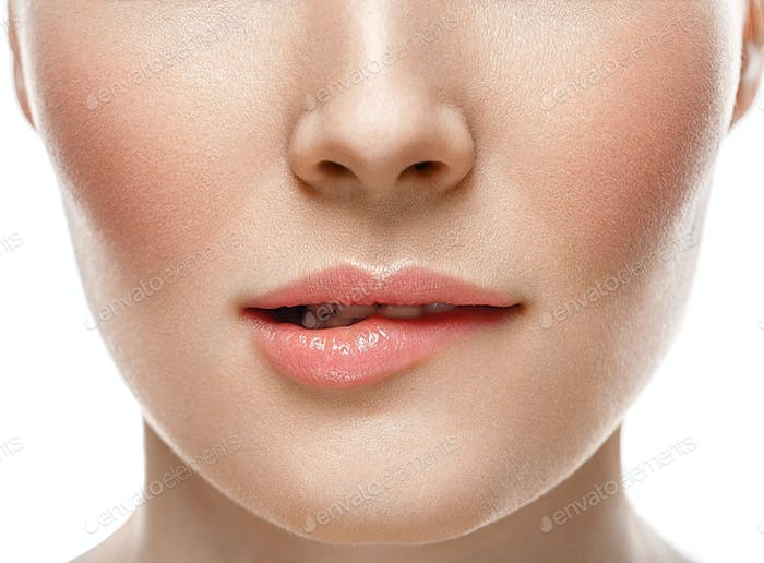 Woman face lips and nose studio white background