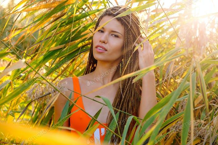 Portrait of  woman in swimsuit among plants