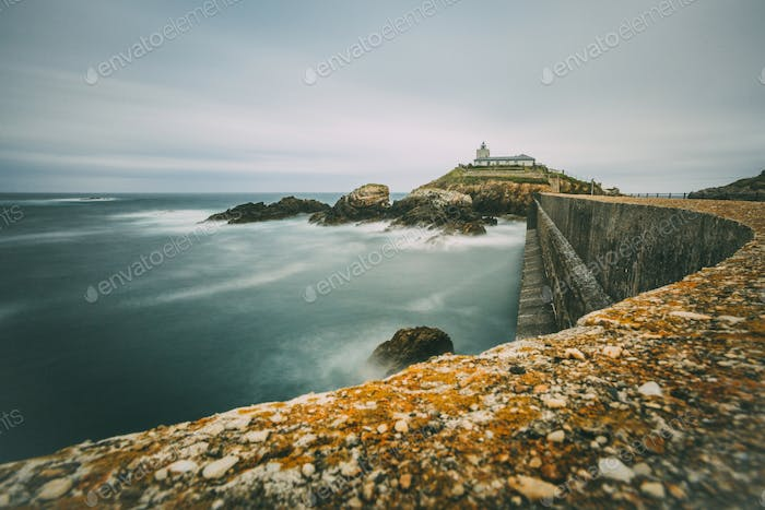 Long exposure of Cantabrian sea with lighthouse