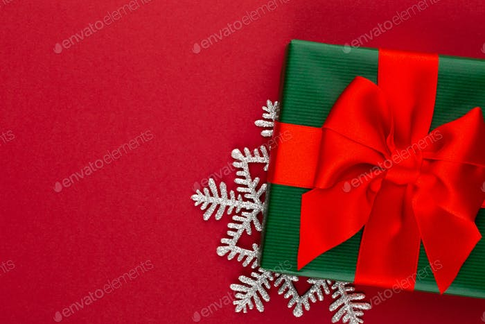 Christmas, holiday present box on red background.