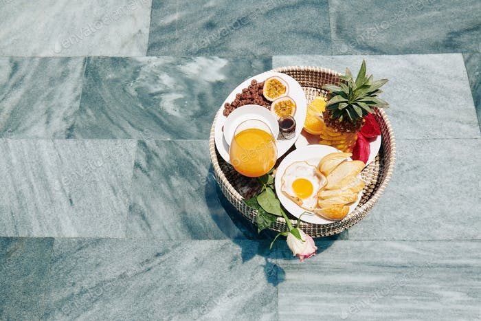 Wicker tray with delicious breakfast
